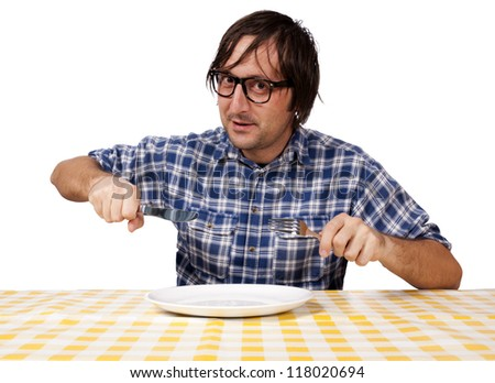 Man want to eat but the plate is empty - stock photo