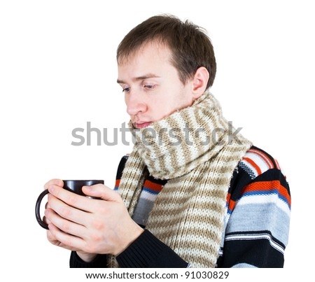 man warming up with hot tea in wintertime - stock photo