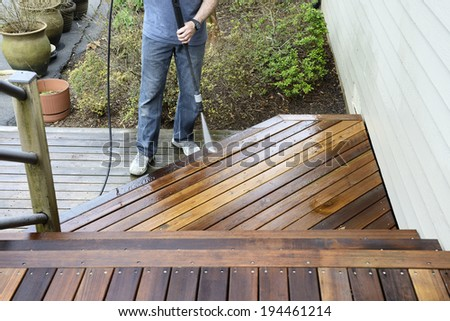 Man Washing Deck - stock photo