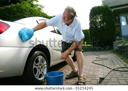 Man washing the silver car