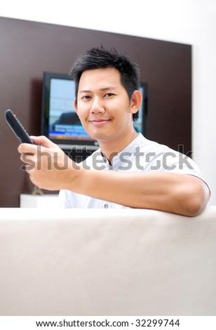 Man watching television - stock photo