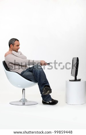 stock-photo-man-watching-television-9985