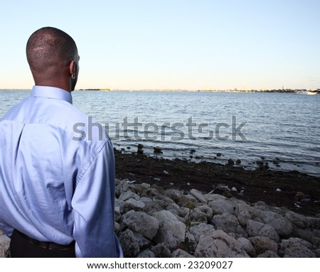 Man watching the horizon - stock photo