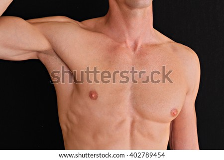 Man Waxing. Muscular male torso, chest and armpit hair removal close up.