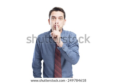 Man wearing a blue shirt and red tie. He doing the silence gesture.Over white background - stock photo