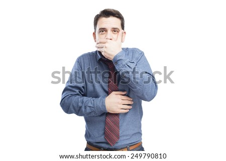 Man wearing a blue shirt and red tie. He is covering his mouth with his hands. Over white background - stock photo