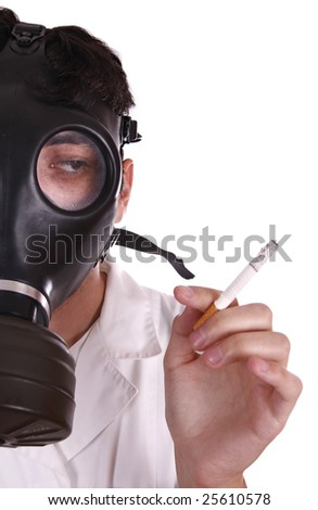 Man wearing a gas mask and holding a cigarette - healthy life concept