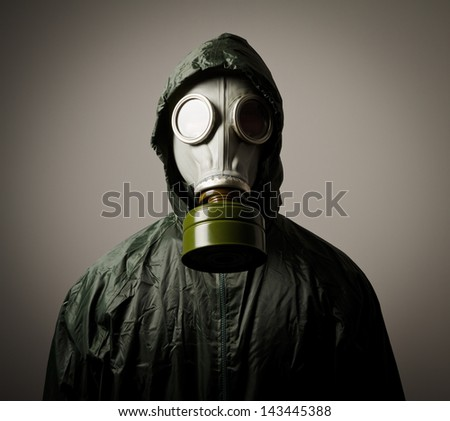 Man wearing a gas mask on his face - stock photo