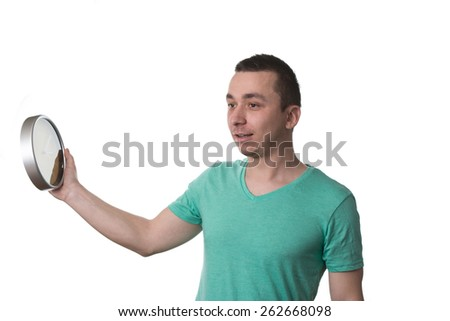Man Wearing A Green T-shirt And He Is Holding A Clock - Over White Background Isolated
