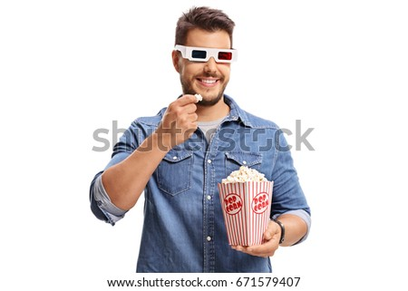 Man wearing a pair of 3D glasses and eating popcorn isolated on white background