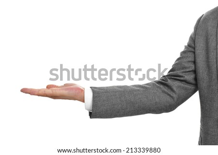 man wearing a suit with his hand open, as begging or showing or holding something - stock photo