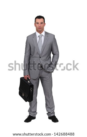 Man wearing an oversized suit - stock photo