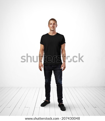 Man wearing black t-shirt - stock photo