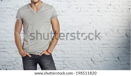 man wearing blank grey t-shirt - stock photo