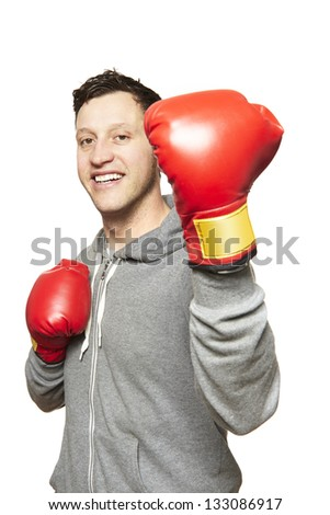 Man wearing boxing gloves smiling on white background