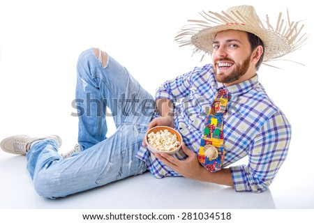 "Man wearing ""Caipira"" clothes for the Brazilian Festa Junina - stock photo"