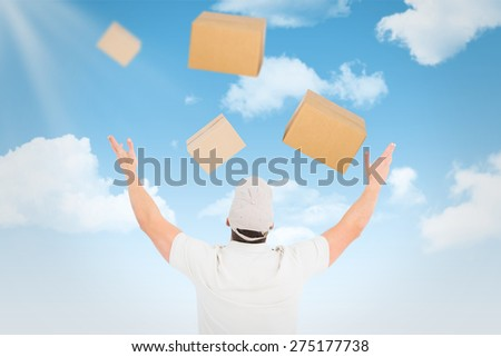 Man wearing cap against blue sky - stock photo