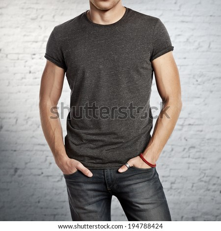 Man wearing dark grey t-shirt - stock photo