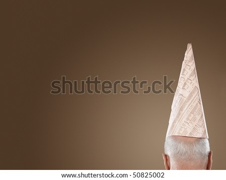 Man Wearing Dunce Hat, high section, back view - stock photo