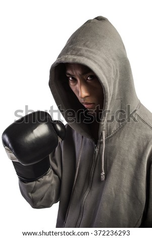 man wearing hood in boxing gloves isolated on white