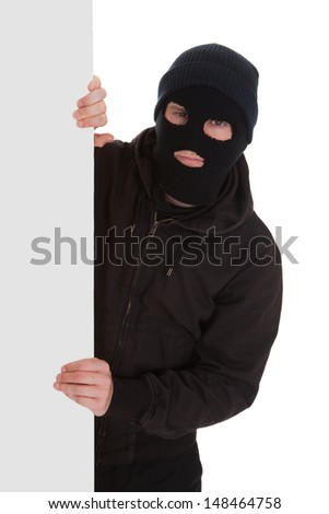 Man Wearing Mask Holding A Blank Card Over White Background