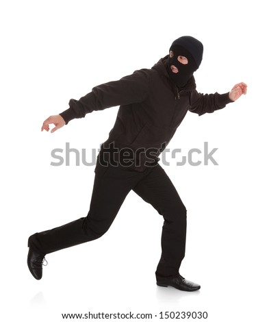 Man Wearing Mask Running Over White Background - stock photo