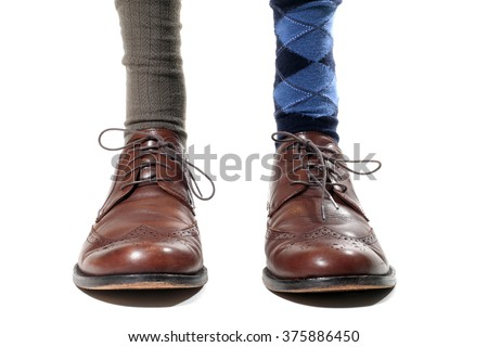 Man Wearing Mismatched Dress Socks