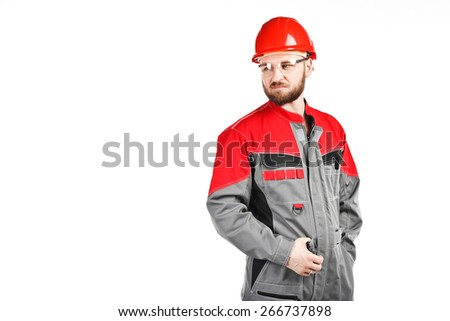 man wearing overalls with red helmet on white background - stock photo