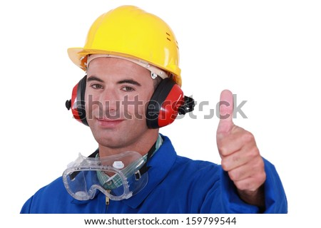 Man wearing safety goggles - stock photo