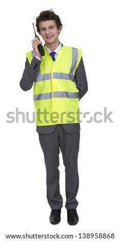 Man Wearing Security Jacket Talking On Walkie Talkie Isolated Over White Background
