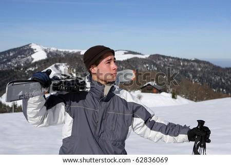Man wearing skis - stock photo