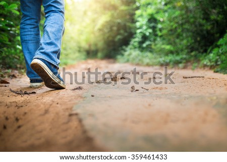 Man wearing sneakers in the forest