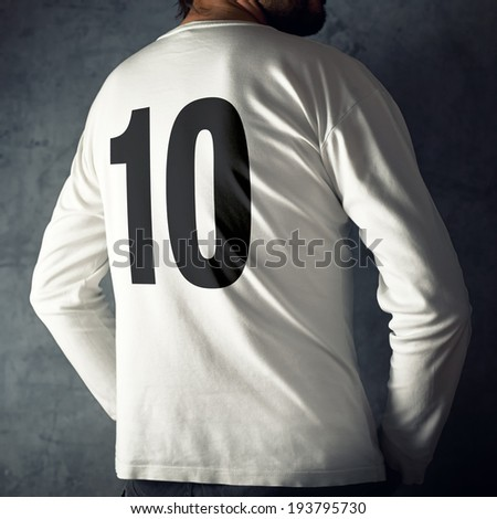 Man wearing sport shirt with number ten printed ion his back.