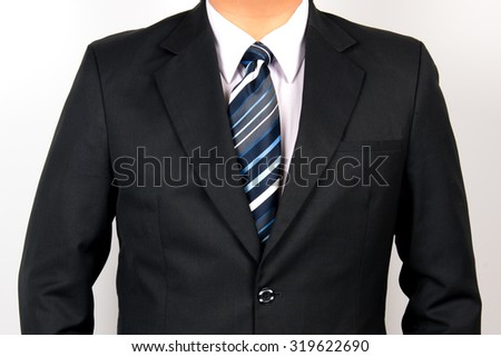 man wearing suit and striped tie - stock photo