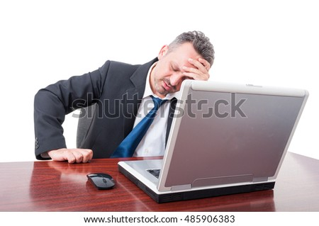 Man wearing suit at office being very tired and pulling his tie isolated on white background