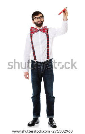 Man wearing suspenders writing with big pencil on space. - stock photo