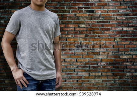Man wearing T-Shirt  with clipping path on T-Shirt for useful for add your design.