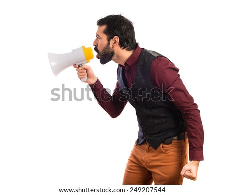 Man wearing waistcoat shouting by megaphone   - stock photo