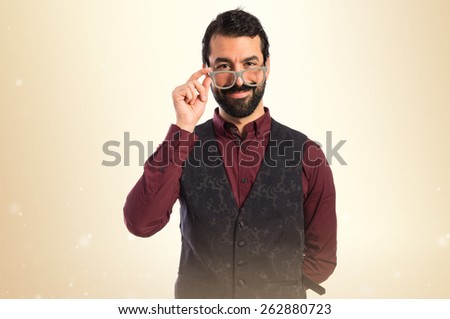 Man wearing waistcoat with glasses