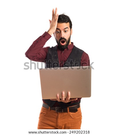 Man wearing waistcoat with laptop
