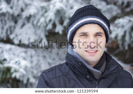 Man wearing warm clothes on a cold winter day - stock photo