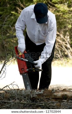 man wearing white shirt,  cutting tree with a chainsaw