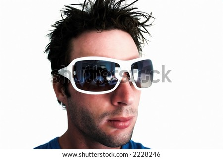 man wearing  white sunglasses (white lights, and back drop) - (slight soft focus) - stock photo