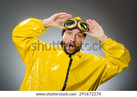 Man wearing yellow suit and aviator glasses - stock photo