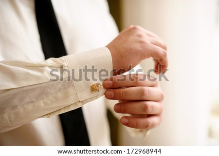 man wears white shirt and cufflinks - stock photo