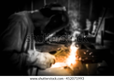 Man welding work,Welding steel sparks,Blurry portrait