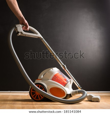 man who cleans the floor of the house - stock photo