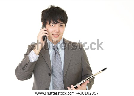 Man who is talking on a smart phone