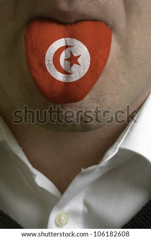 man wit open mouth spreading tongue colored in tunisia flag as symbol of values like teaching, learning, multilingual speaking different of languages - stock photo