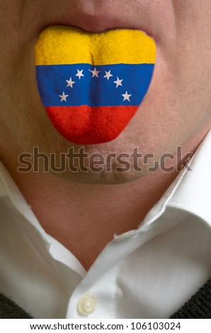 man wit open mouth spreading tongue colored in venezuela flag as symbol of values like teaching, learning, multilingual speaking different of languages - stock photo